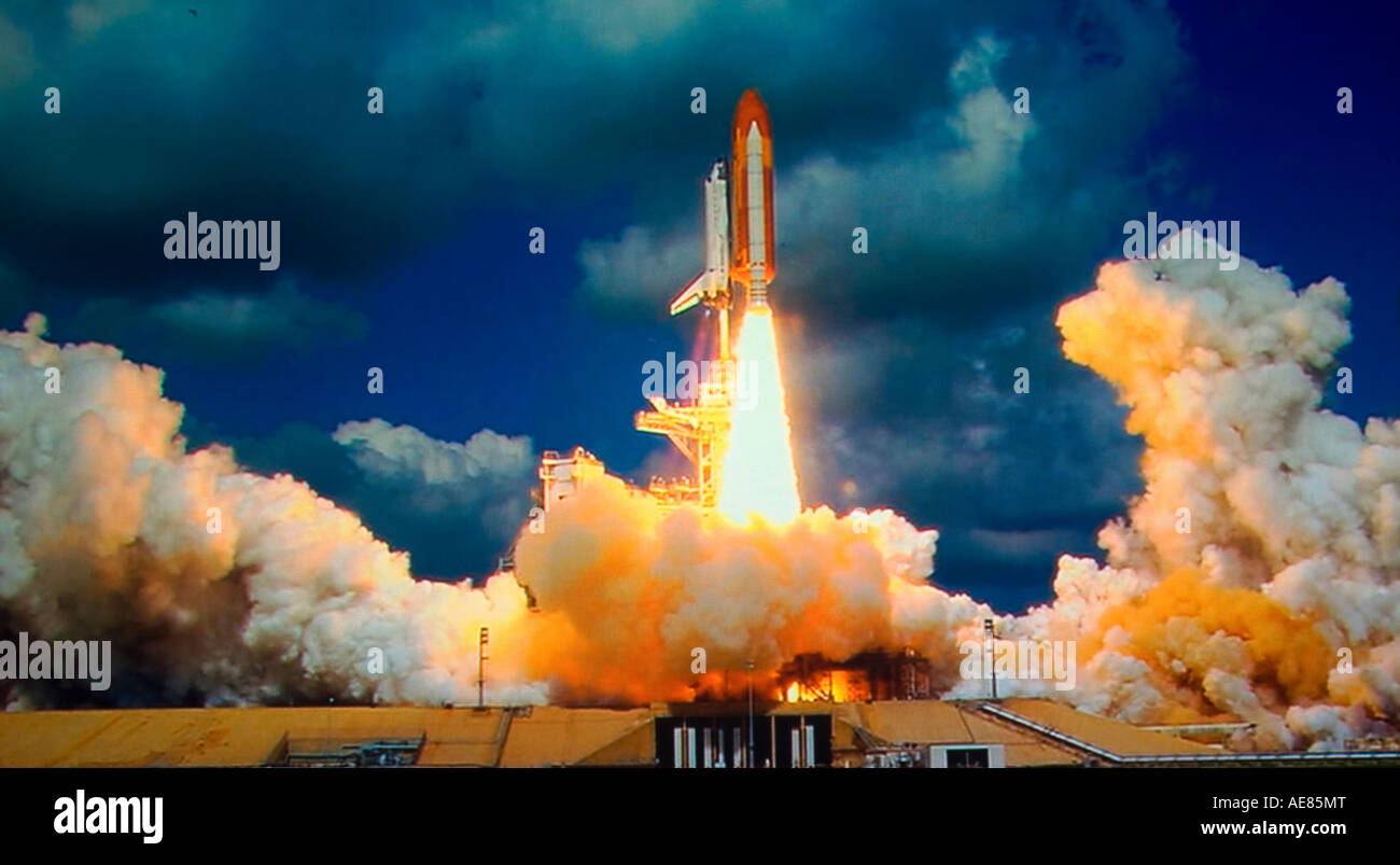 NASA shuttle lifting off from Cape Canaveral, Florida on exploratory mission into outer space - Stock Image