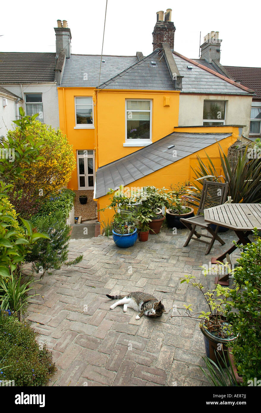 Colourful Terraced House With Small Rear Paved Garden Stock Photo