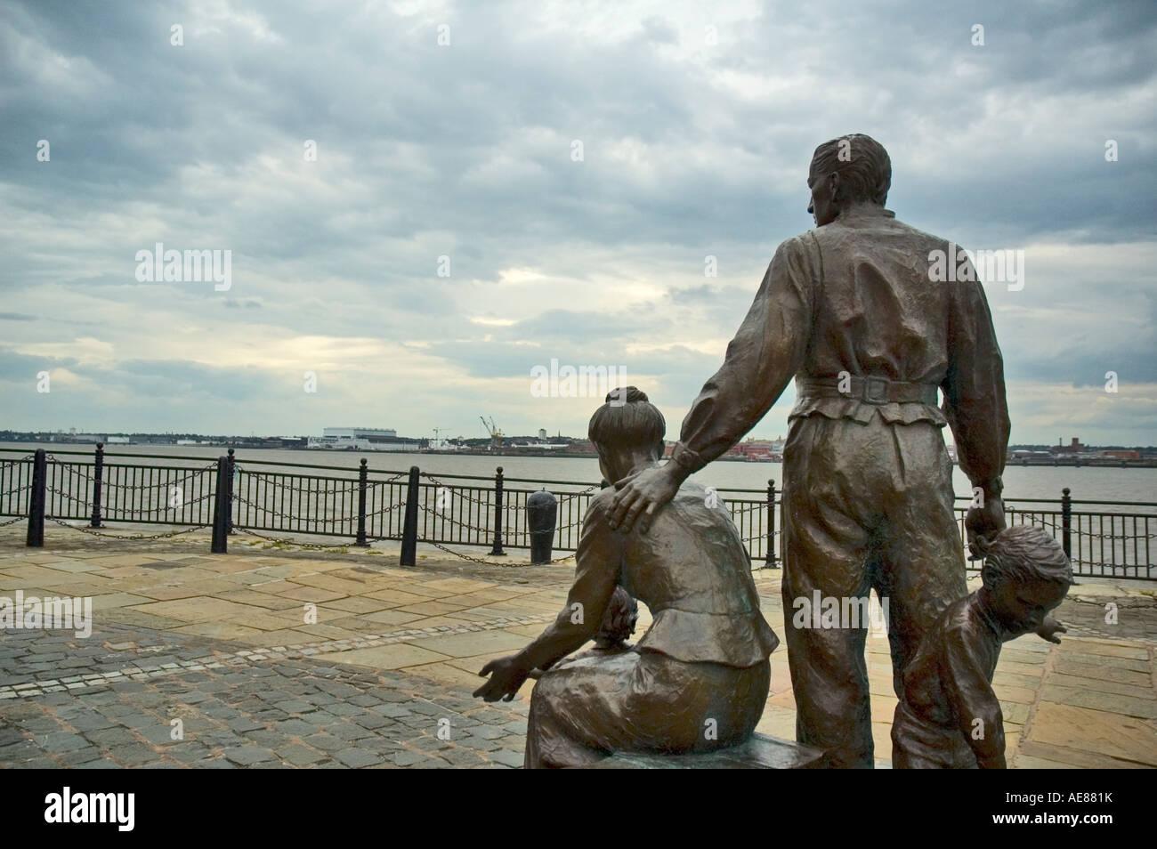 Emigrants, a statue near the pier head. Liverpool, Merseyside, England, UK - Stock Image