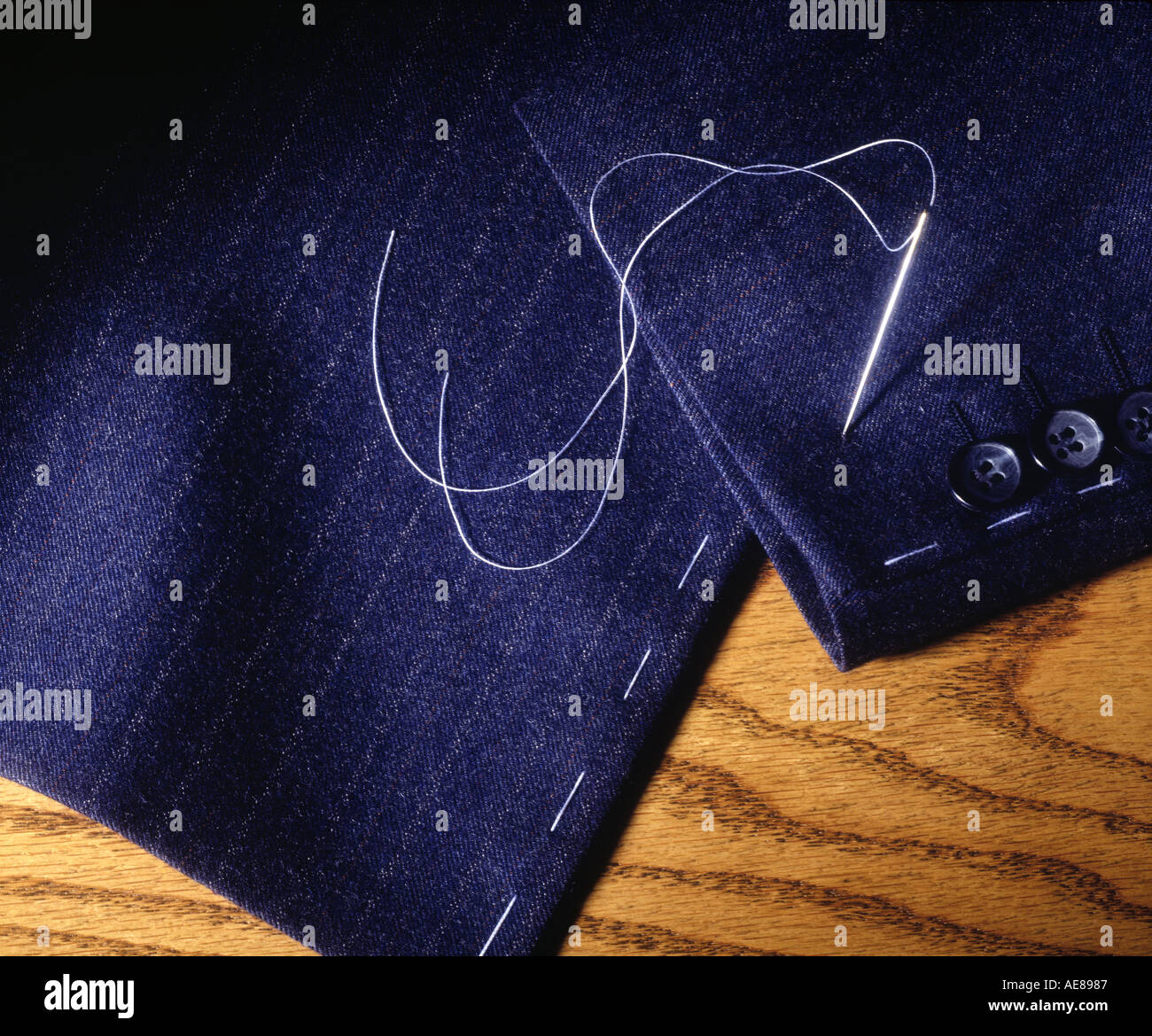 Needle Thread Sewing Repair Fabric Stitch Mending Join Material Repairs Alters Garment Suit Coat Sew Taylor Close-up - Stock Image