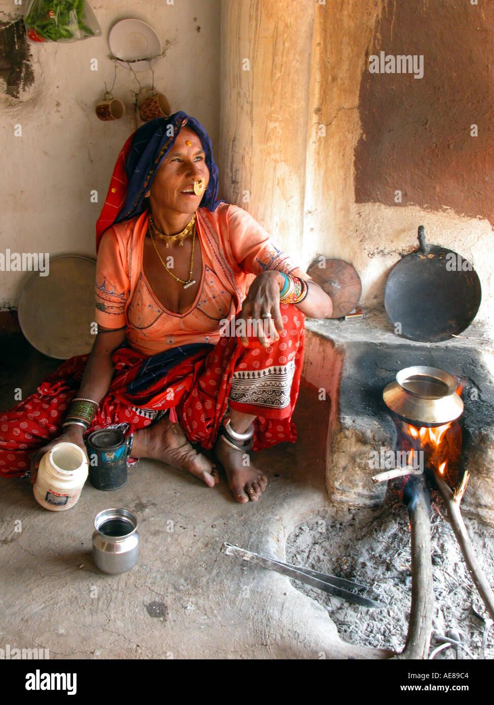 Bishnoi woman making tea India Rajasthan - Stock Image