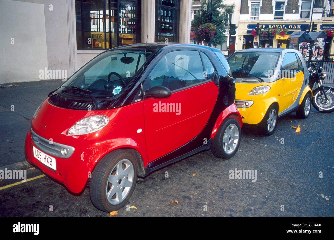 Smart cars on London street in England These fuel efficient cars are ...