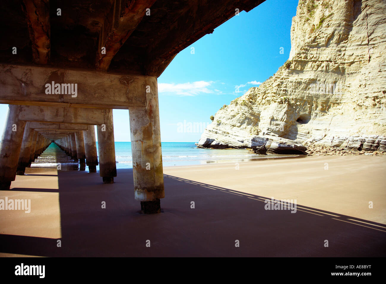 Wharf at tolaga bay East cape underneath - Stock Image