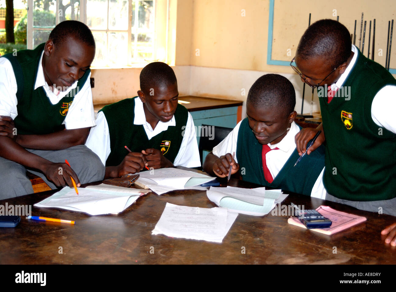 Four students studying inside the Physics Laboratory at Maseno School Kenya East Africa - Stock Image