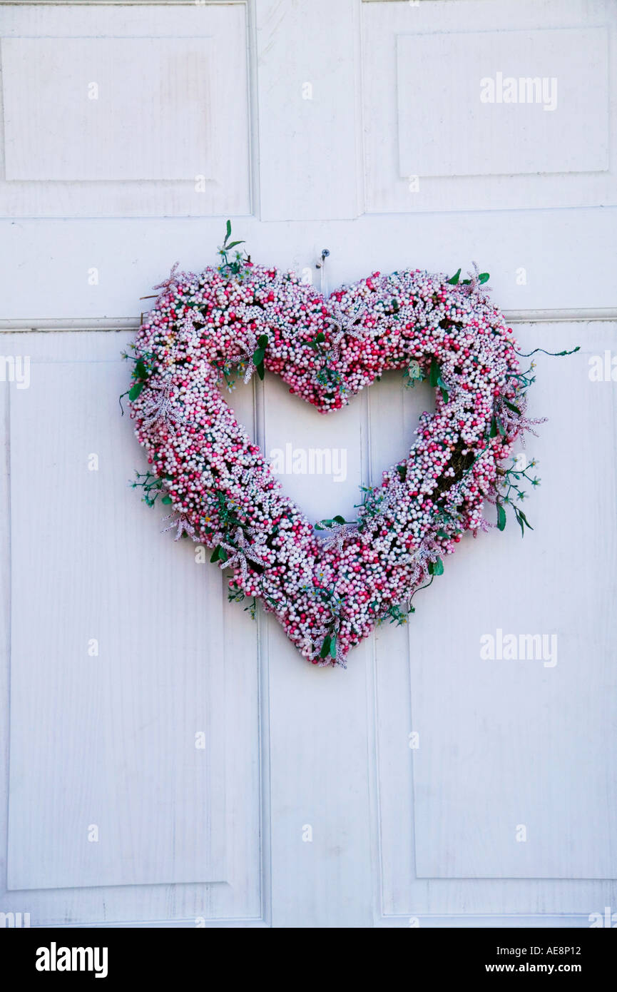 Wreath heart on old door - Stock Image