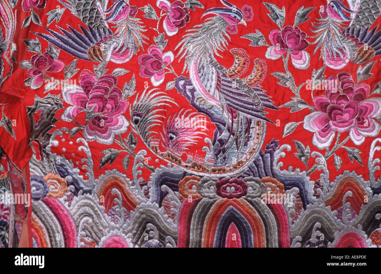Silk embroidered textile Chinese garment China - Stock Image