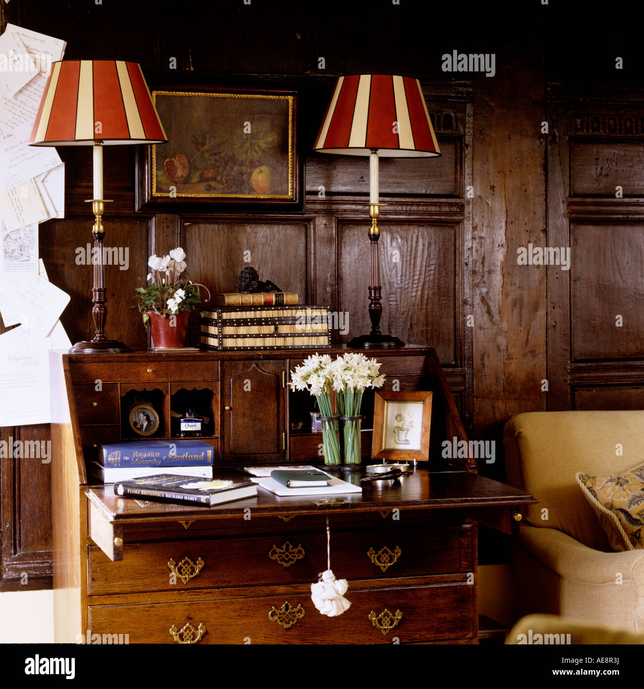 bureau english Striped lampshades on wooden writing bureau in english country house