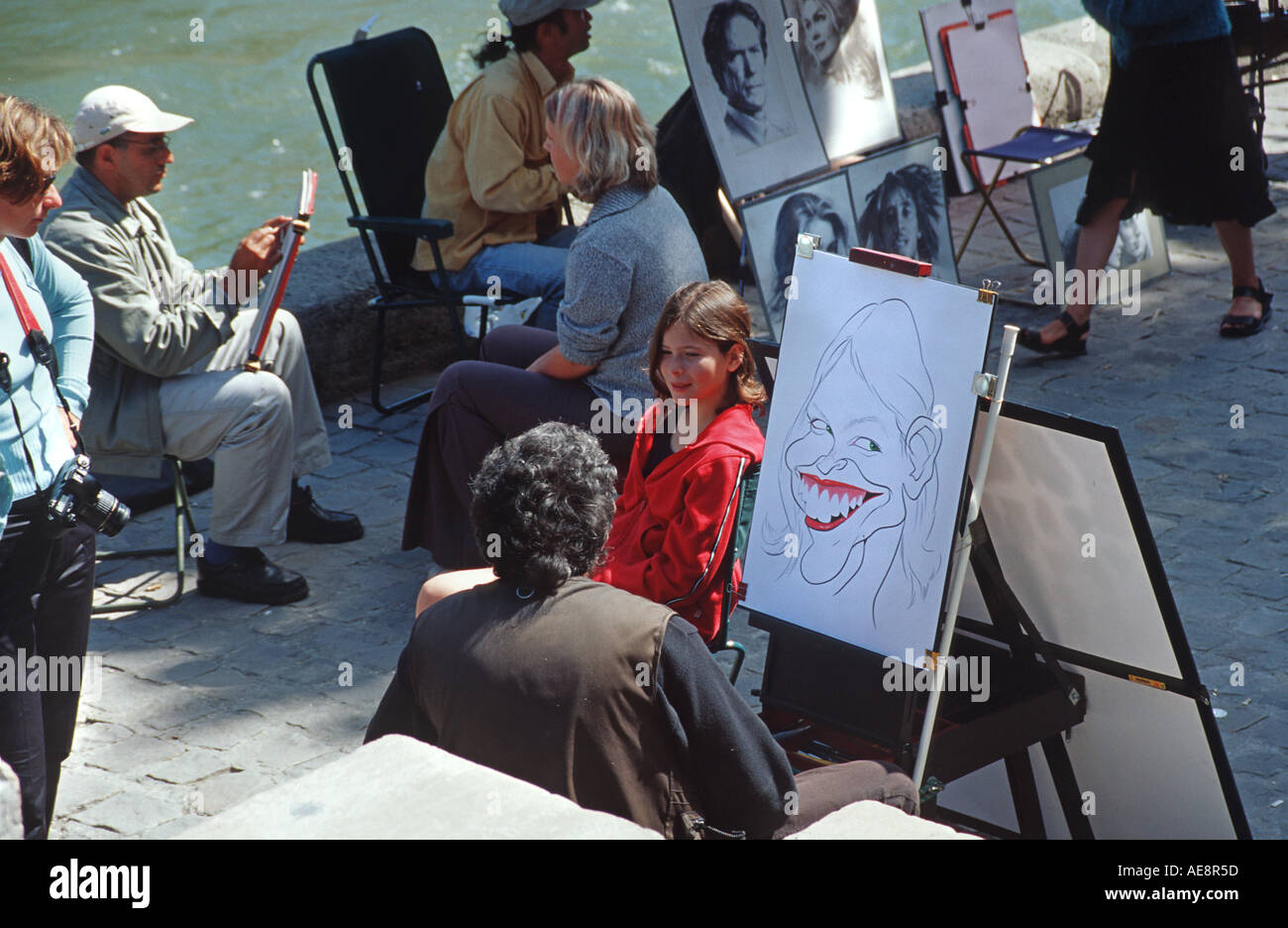 Youngster having a caricature of herself drawn by a street artist paris France - Stock Image