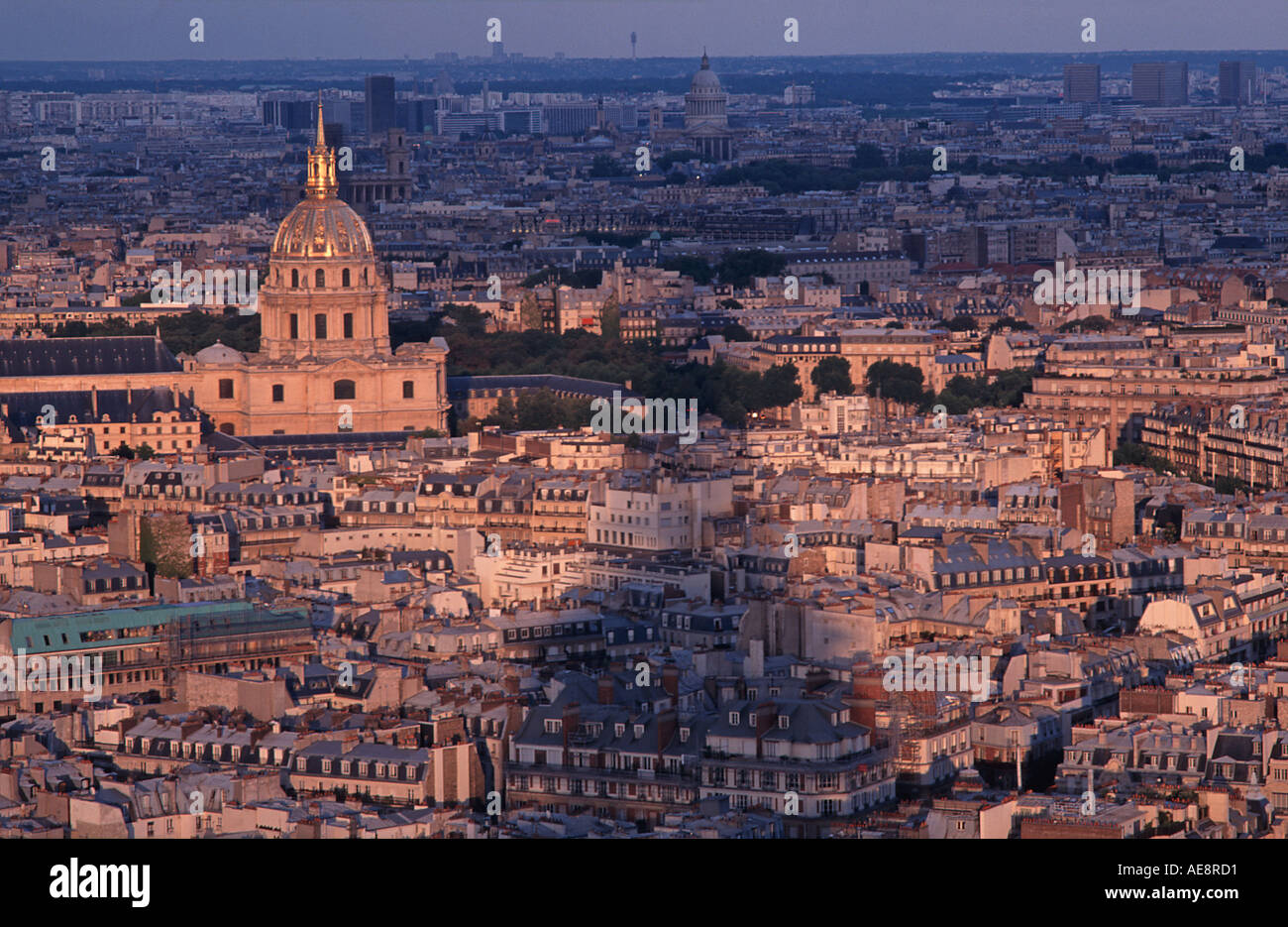 Sunset view from the Eiffel Tower across Paris towards the golden dome of the church of Saint Louis des Invalides France - Stock Image
