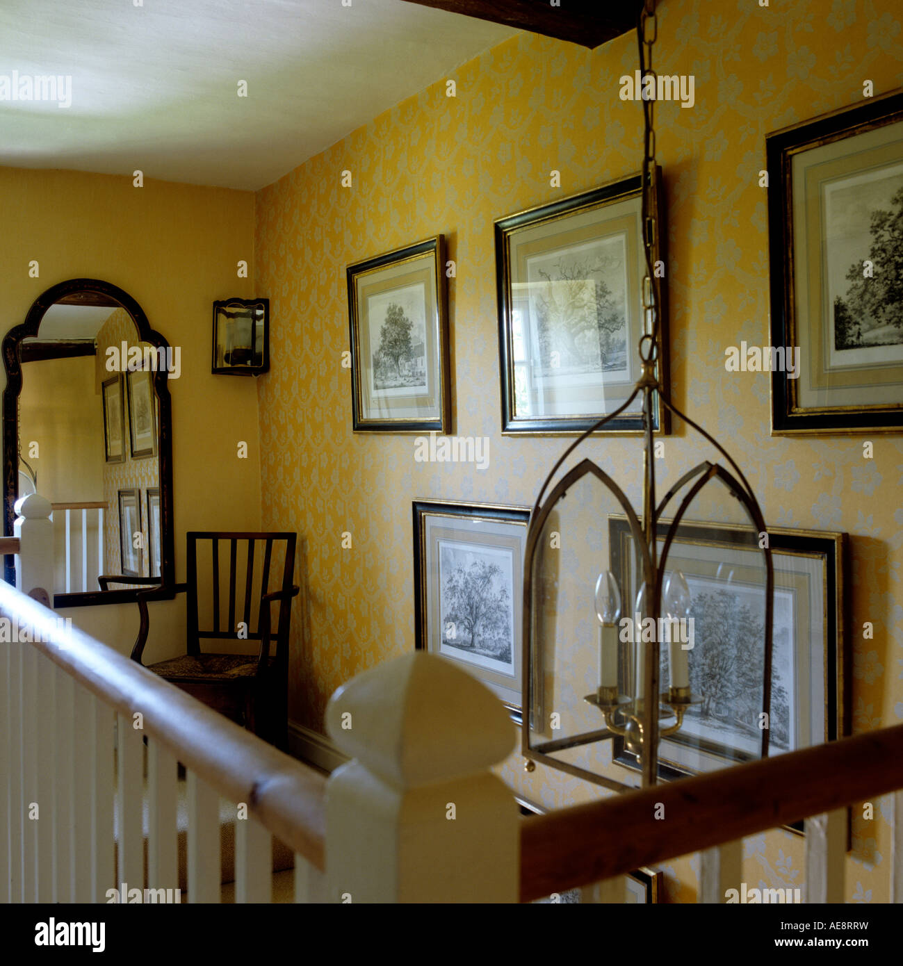 Staircase Landing With Wooden Banister And Old Artwork In 17th Century  Longhouse