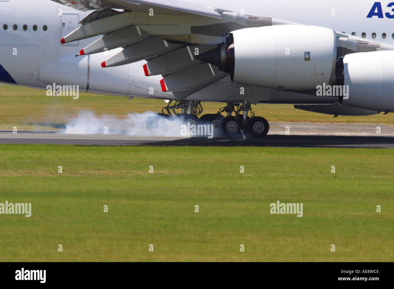 A380 Airbus A380 new airliner touchdown landing with tyre smoke smoking wheels undercarriage - Stock Image