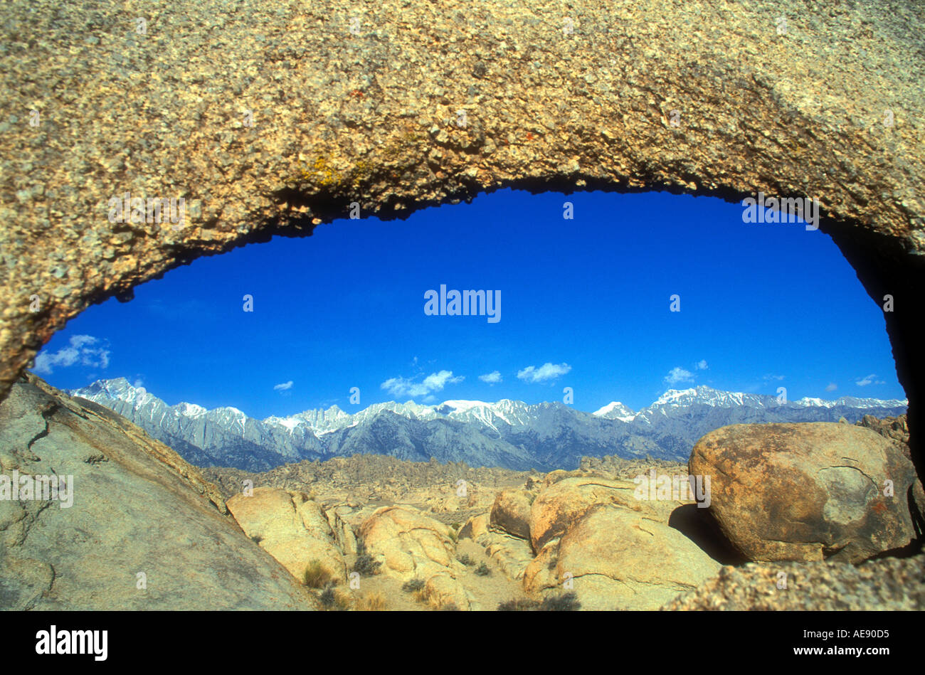 View through archway at Mount Whitney in the Eastern Sierra Nevada mountains rising above the Alabama Hills in California - Stock Image