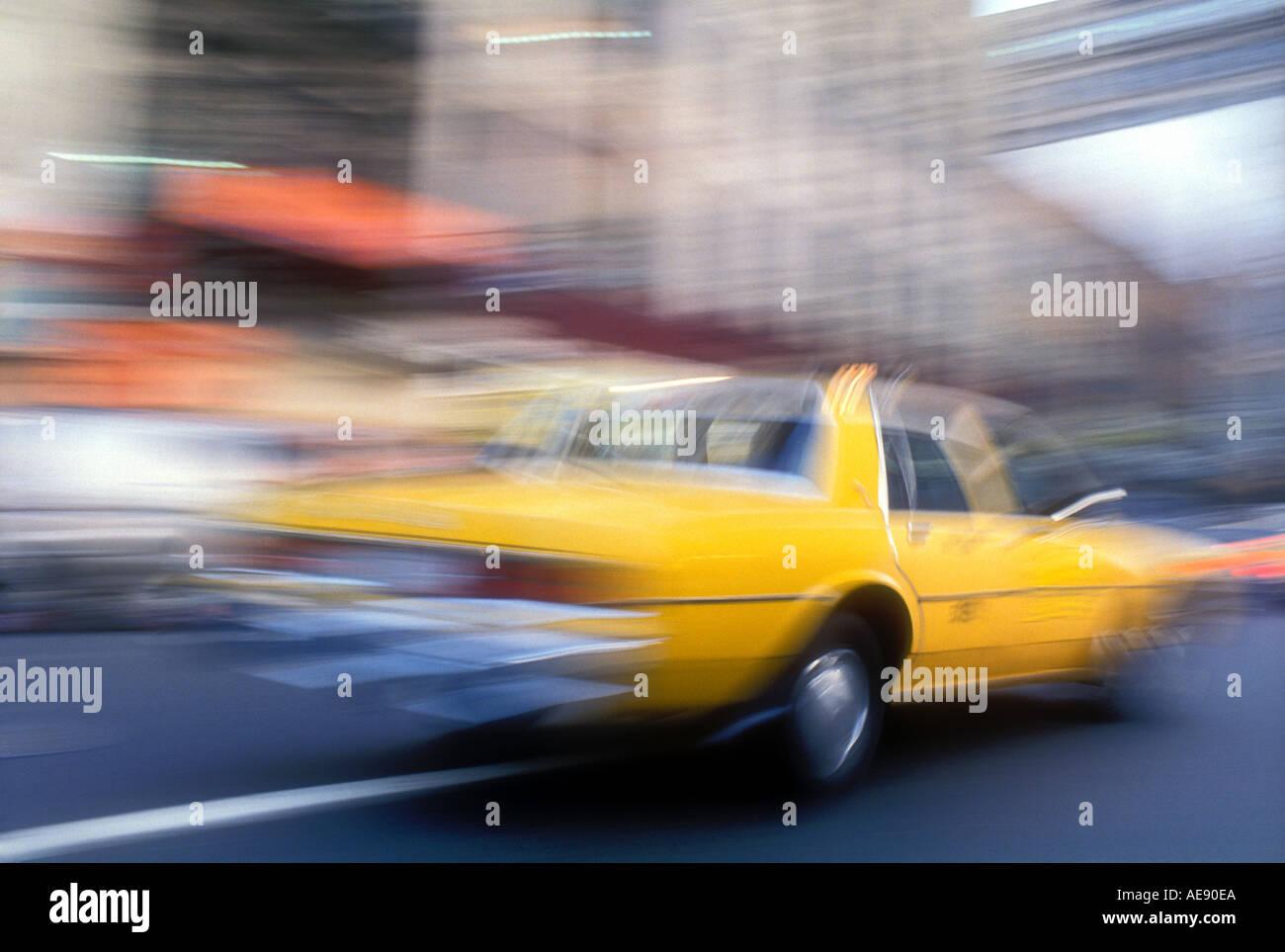 Blurred taxi speeding in New York City New York USA Stock Photo