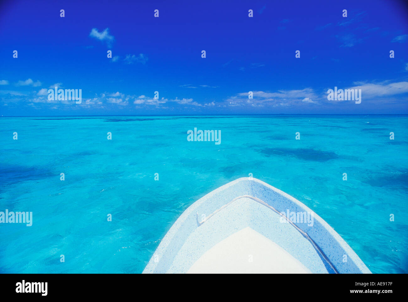 Bow of boat over shallow water in Belize Caribbean Property released image - Stock Image