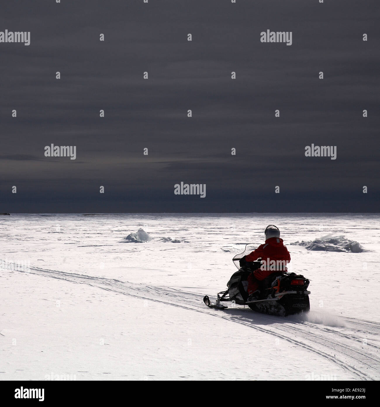 Man on snowmobile Georgian Bay Ontario Canada - Stock Image