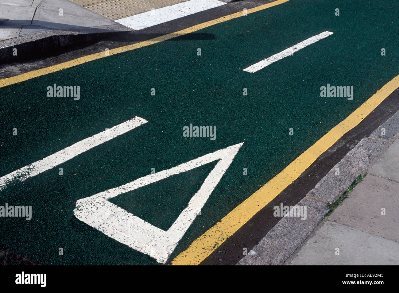 Segregated, two-way cycle lane with freshly layed green tarmac and yellow and white markings, King's Cross, London, England - Stock Image