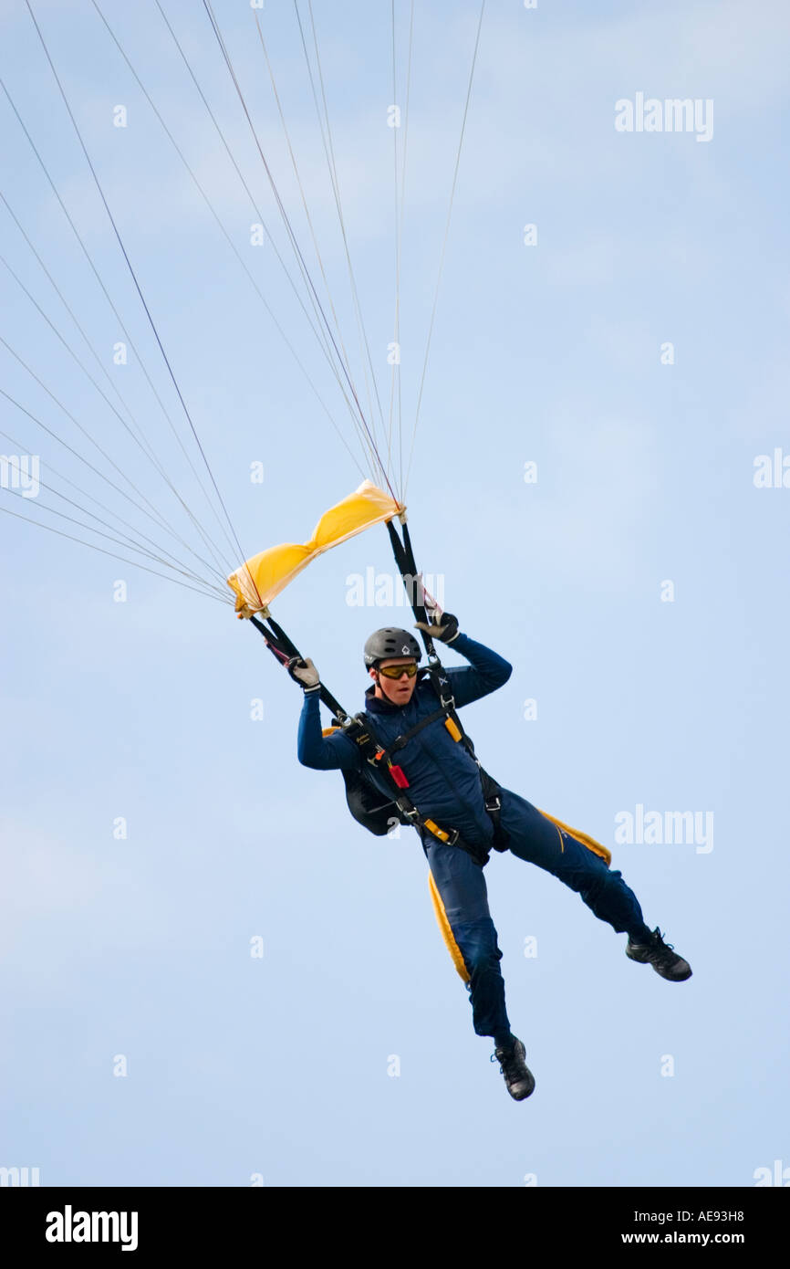 Skydiver from Golden Lions British Army Parachute Display Team coming in for landing - Stock Image