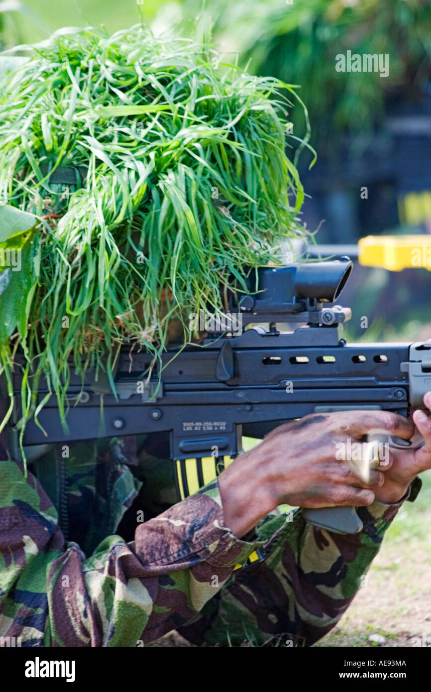 British Army infantry man on excercise shooting SA-80 assault rifle - bullet casing being ejected and flying away - Stock Image