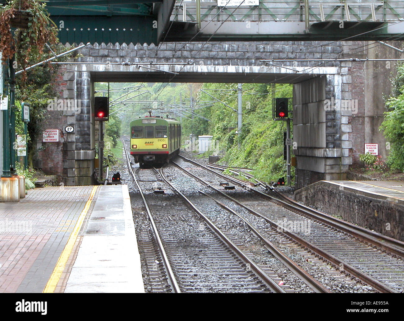 Dart train from Bray approaching Malahide Station Dublin - Stock Image