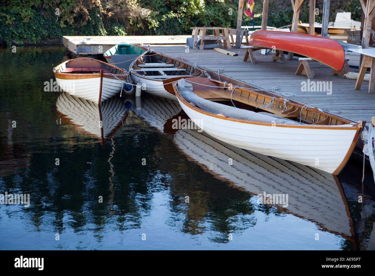 Antique wooden boats tied at pier - Stock Image