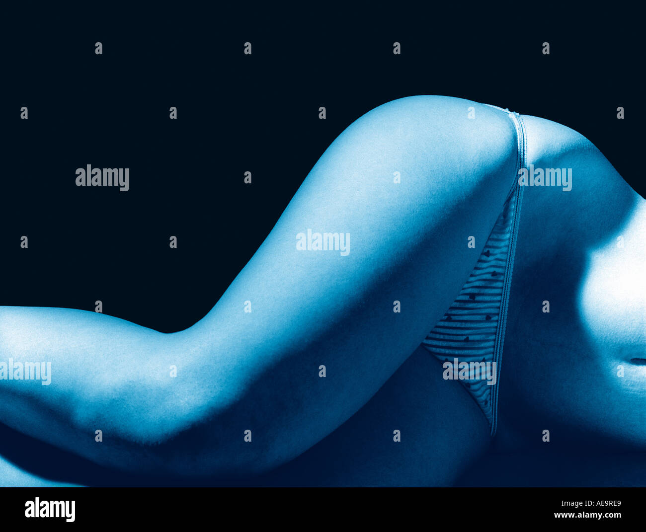 female torso detail blue colour abstract knickers reclining black and white graphic - Stock Image