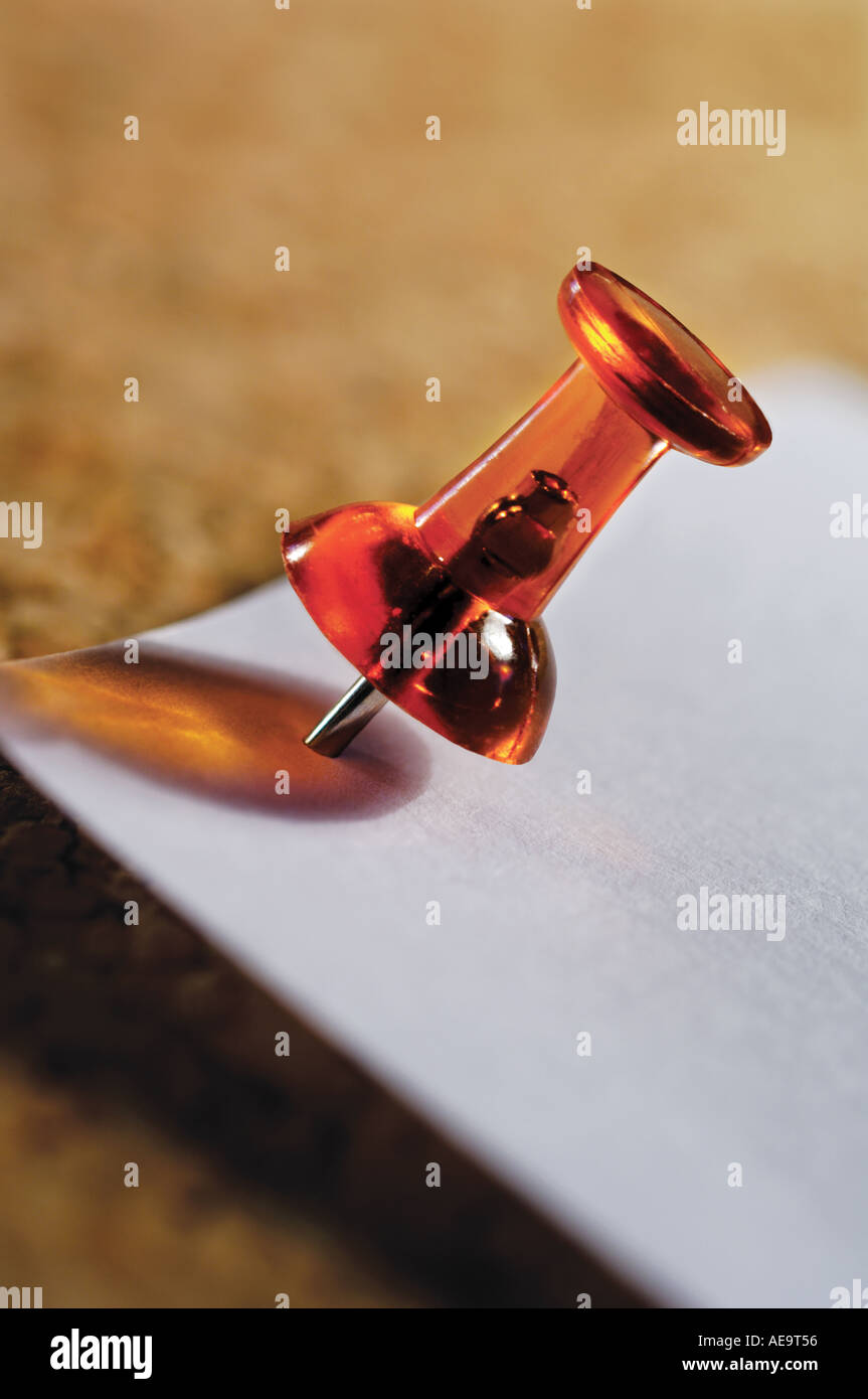 pushpin in memo board - Stock Image