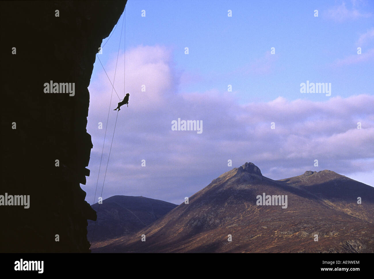 Rock Climber on a hard rock climb called Divided Years in the Mourne Mountains of Ireland - Stock Image