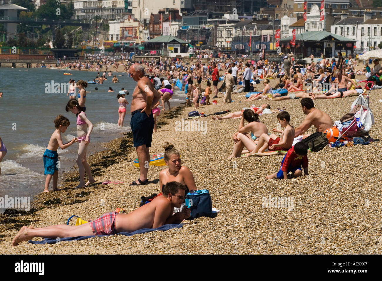 Beach scene grandfather and children Southend on Sea Essex England - Stock Image