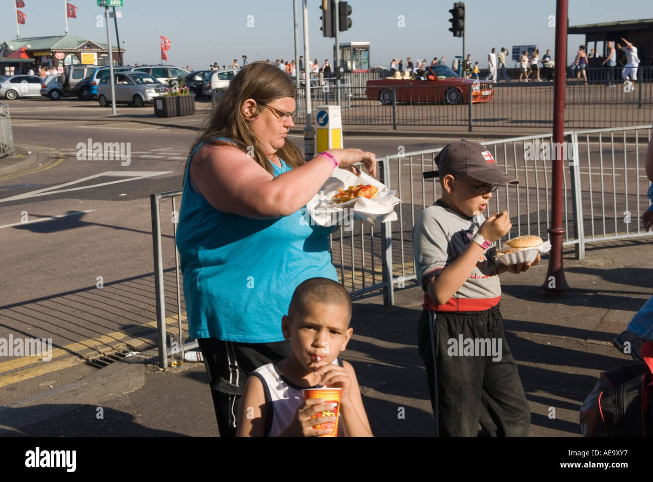 Overweight  fat mother and family  two children eat a fast junk food meal  dinner Southend on Sea Essex England   HOMER SYKES - Stock Image