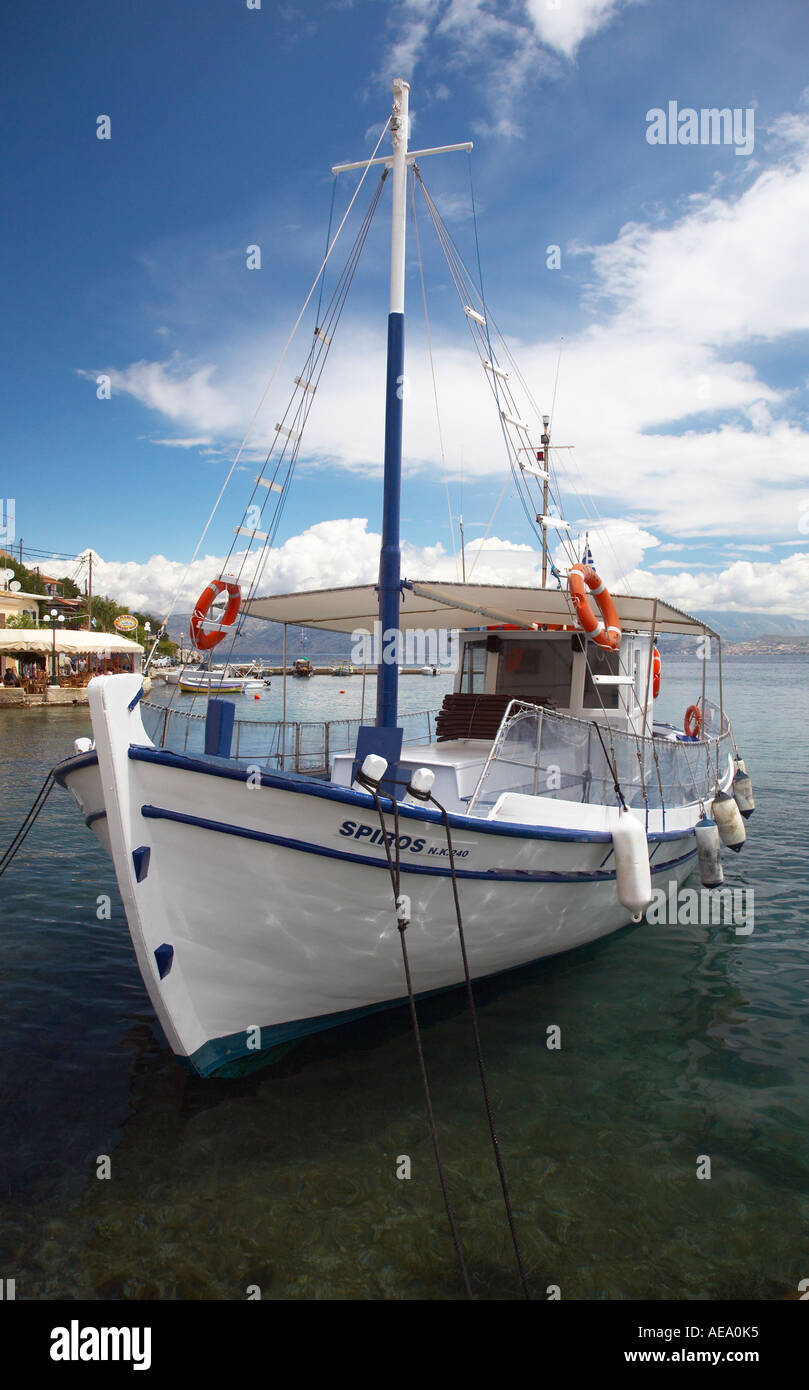 Spiros a small tourist boat in the harbour of Kassiopi Stock Photo