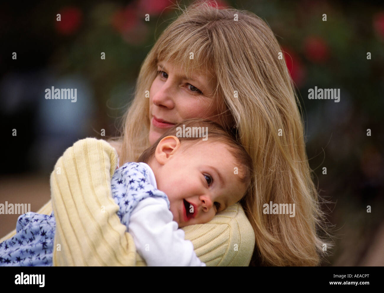 A MOTHER and her one year old baby GIRL MR - Stock Image