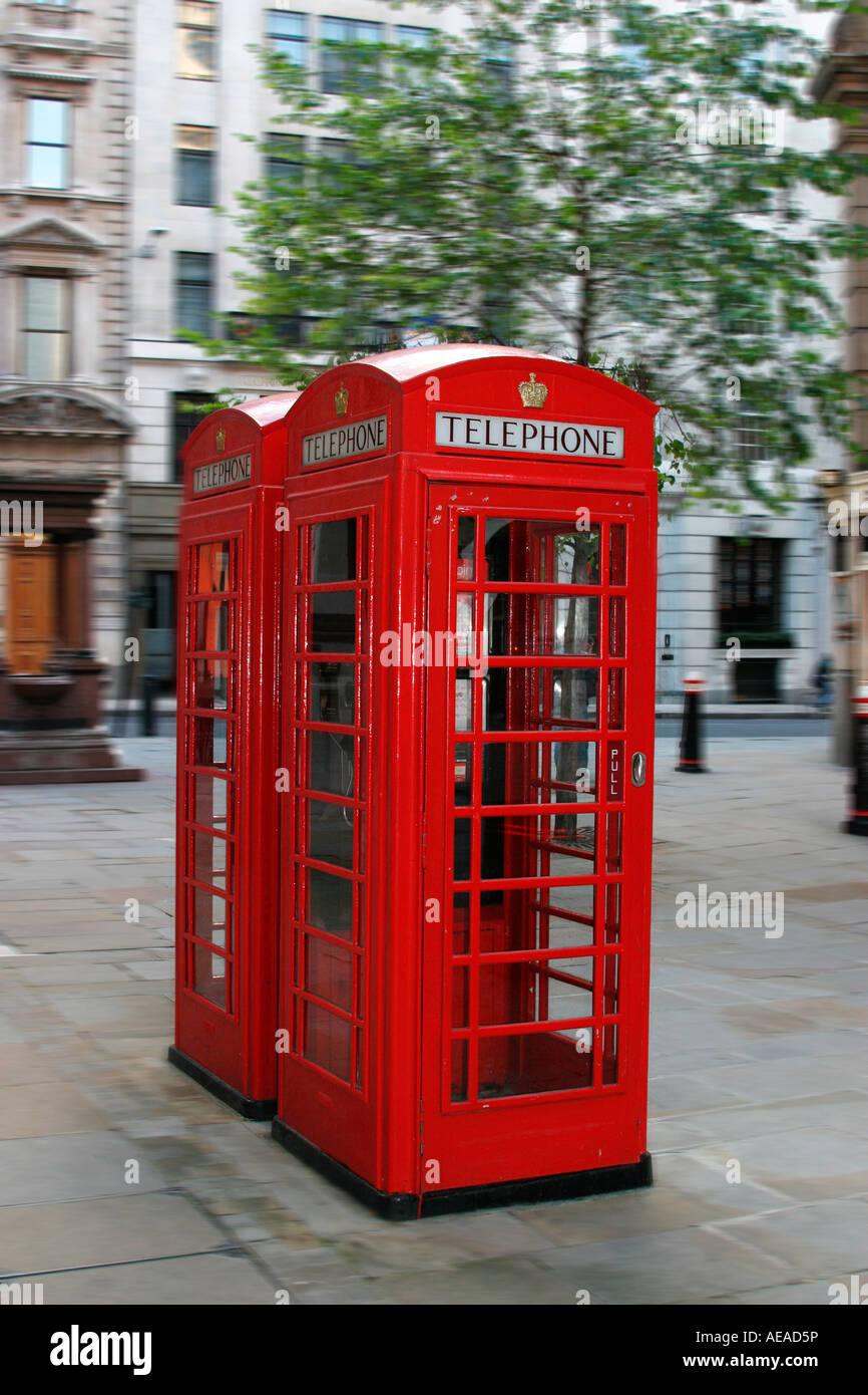 Red telephone box, a public telephone kiosk designed by Sir Giles Gilbert Scott - Stock Image