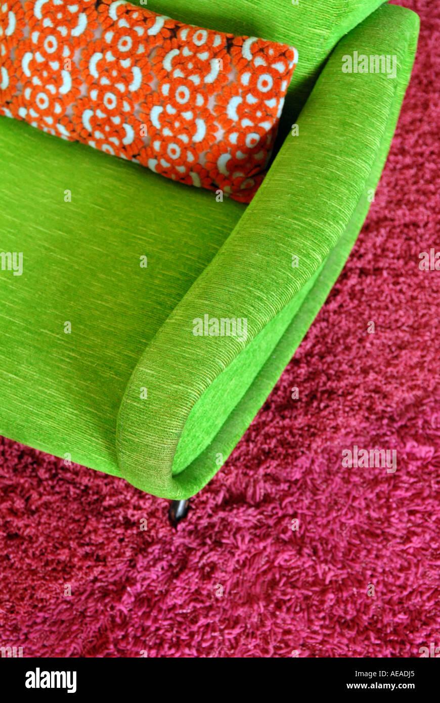 Green seventies chair on Purple shag pile carpet. - Stock Image