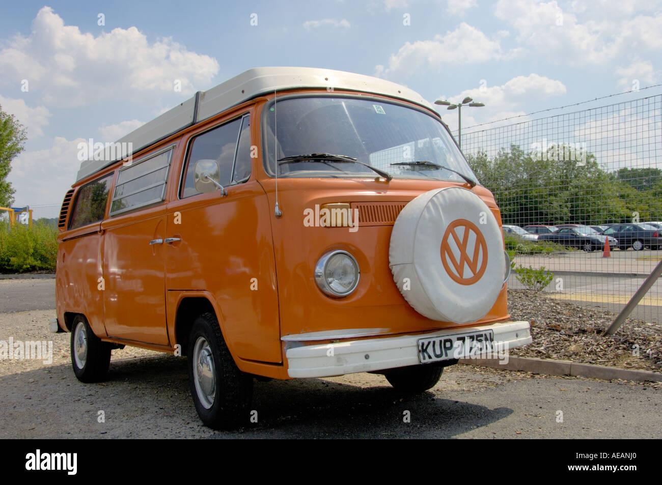 Orange Volkswagon camper van - Stock Image