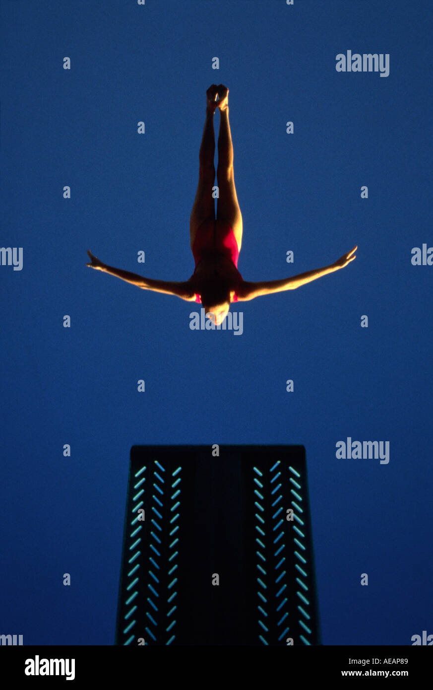 A graphic photographic of a national champion diver doing a swan dive - Stock Image