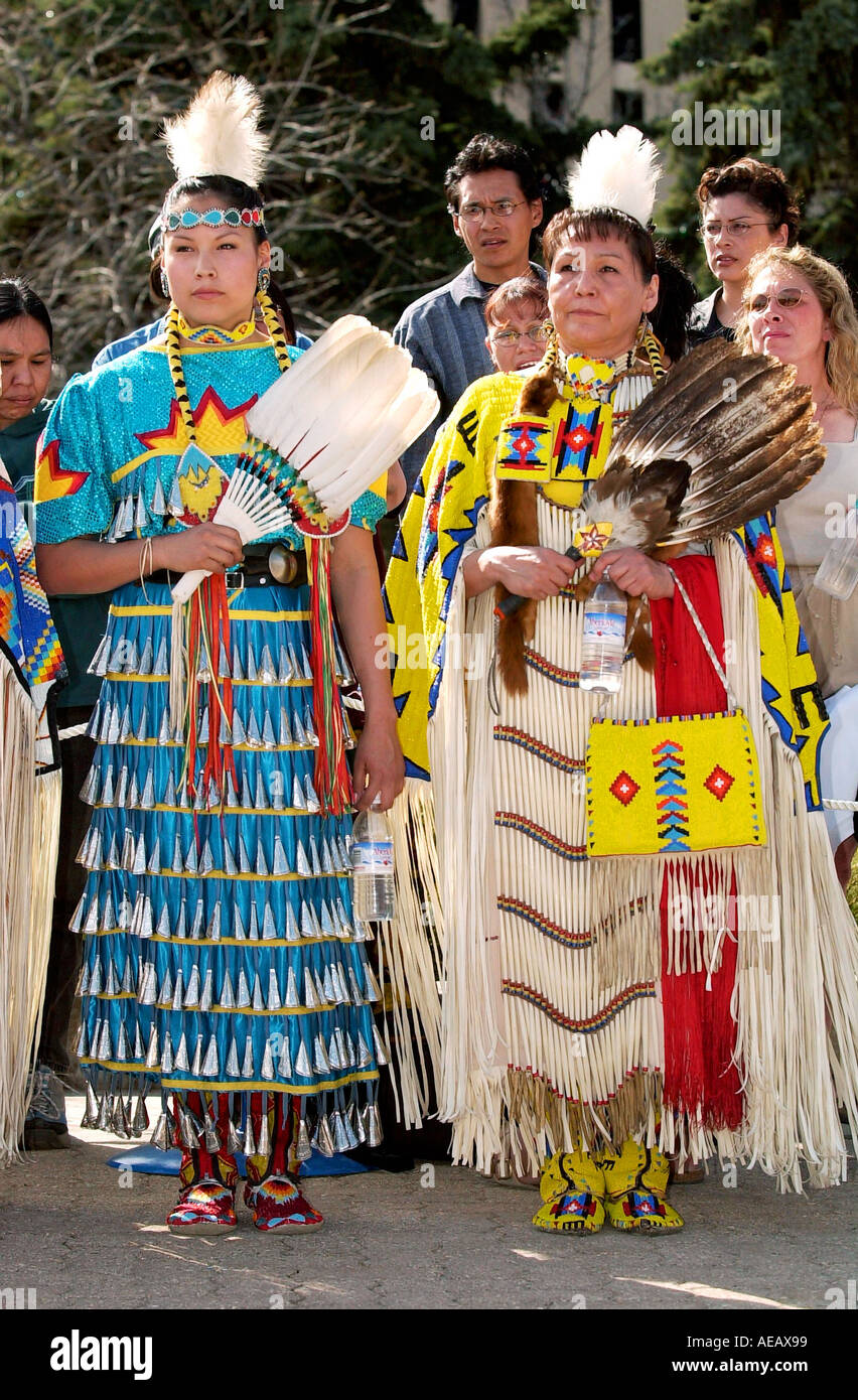Cree First Nation Women In Traditional Native Costume Hold