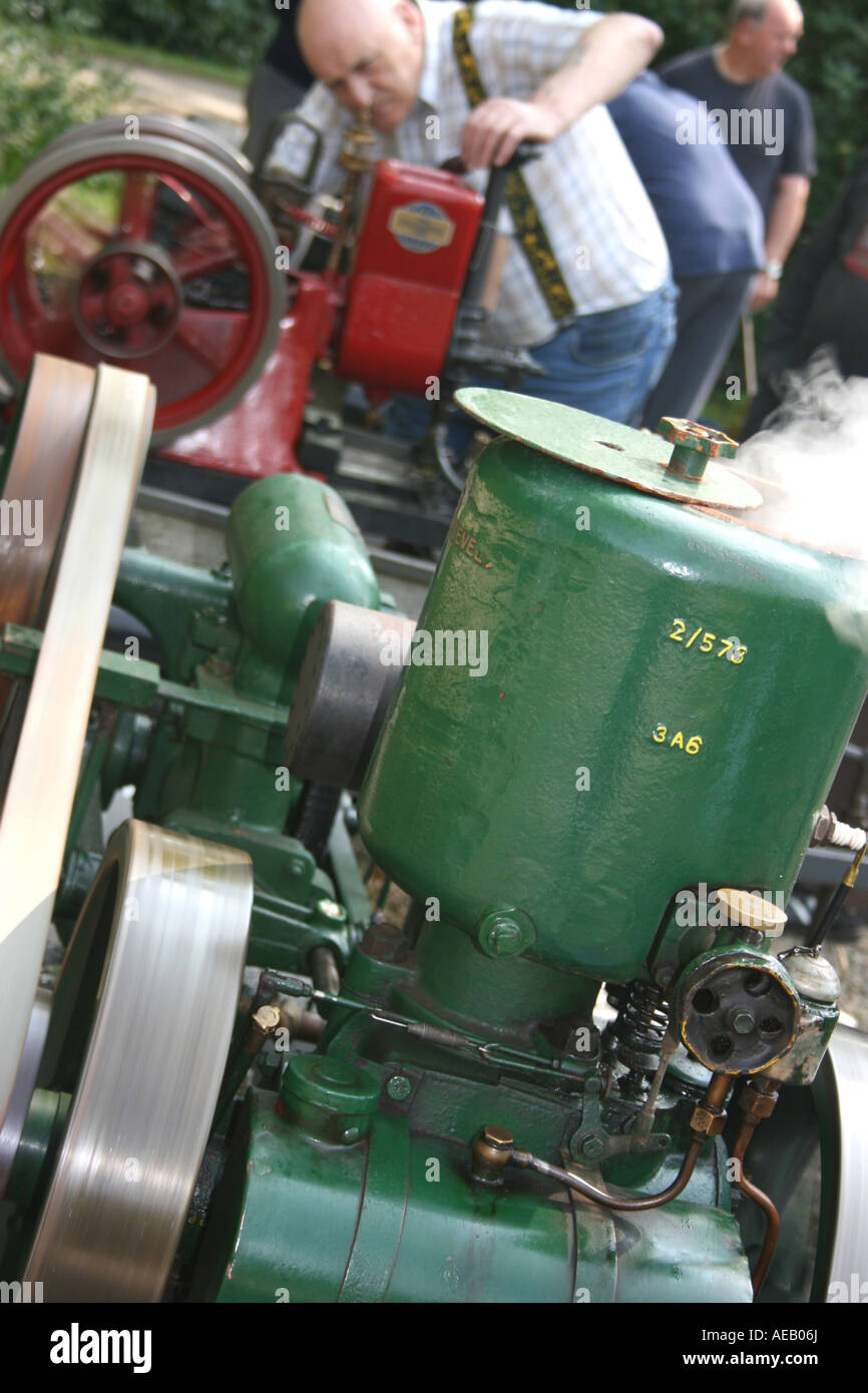 Stationary engine enthusiast tending to his engine at a show in County Armagh, Northern Ireland - Stock Image