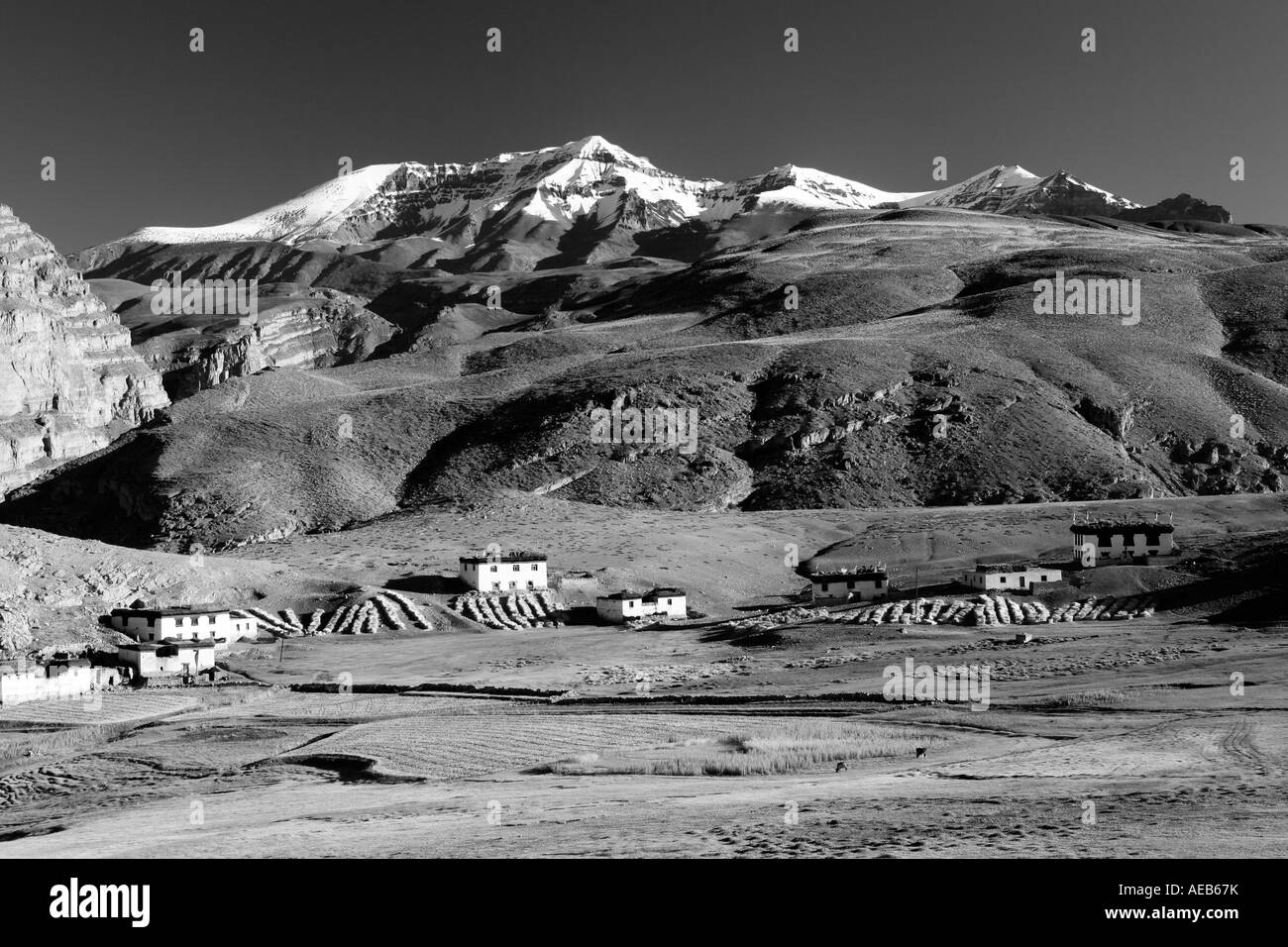 View of village Langza and snow-clad mountains at the backdrop in Spiti Valley, Kaza Himachal Pradesh India Stock Photo
