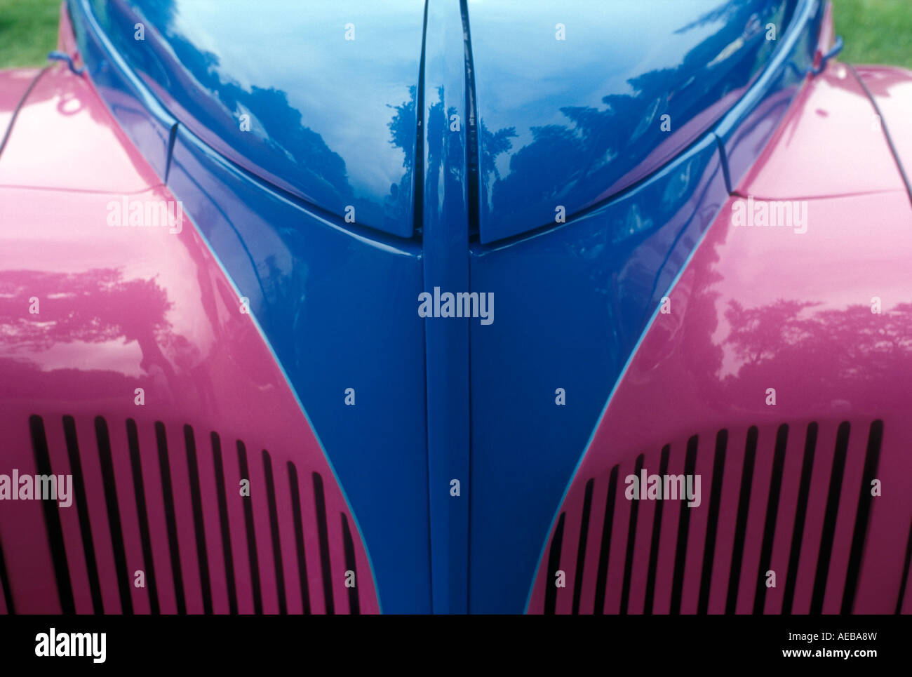 Canada Ontario Niagara on the Lake close up detail of front grille of antique car painted pink and blue - Stock Image