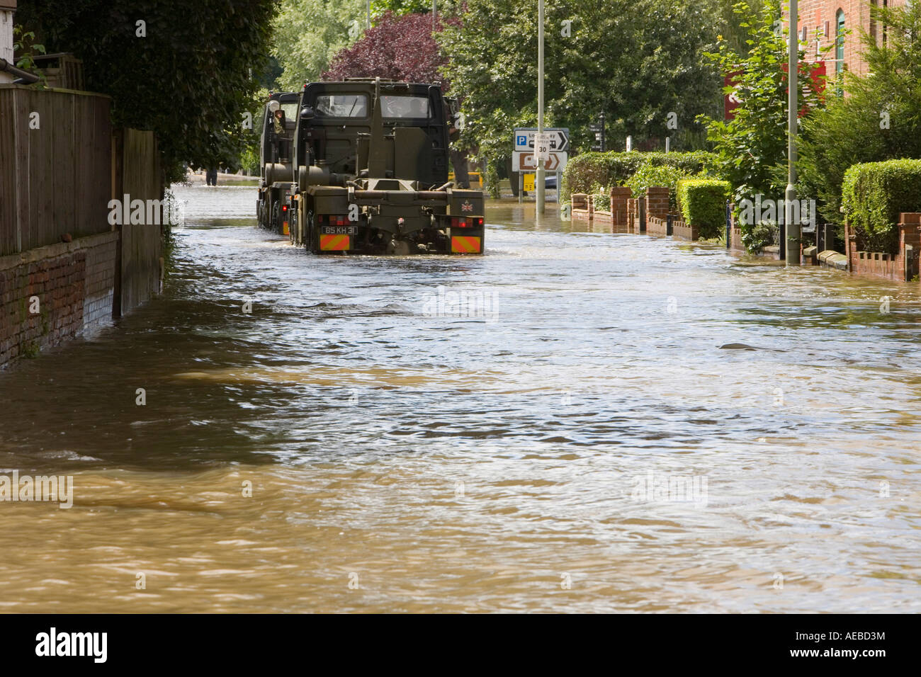 A van driving through floodwaters in Tewkesbury - Stock Image