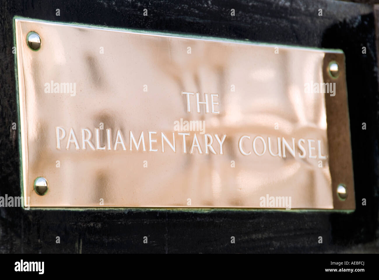 Brass name plaque of The Parliamentary Counsel government office in Whitehall Central London UK - Stock Image