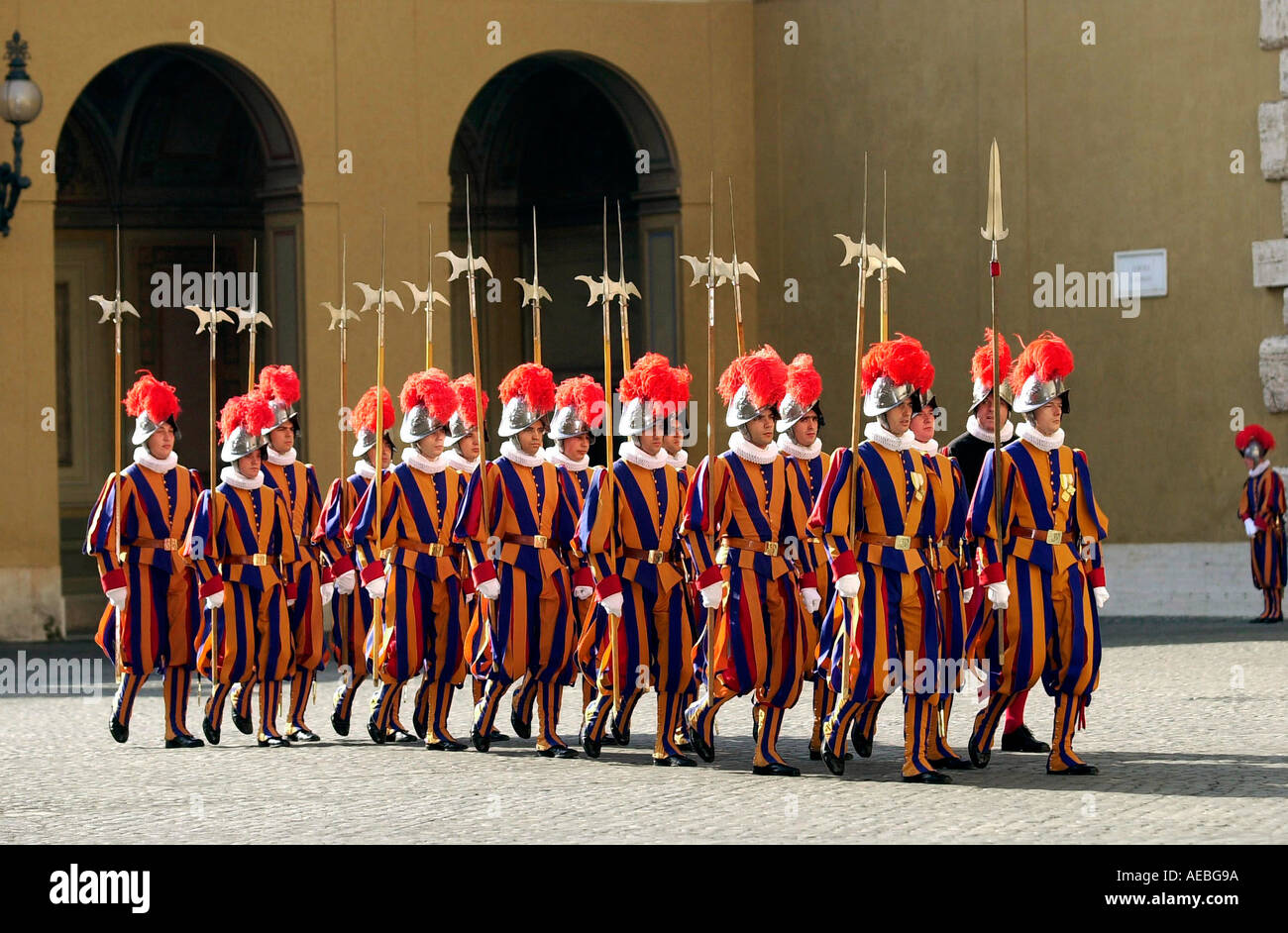 SWISS GUARDS IN PLUMED HELMETS AND STRIPED UNIFORMS AT THE VATICAN CITY Stock Photo