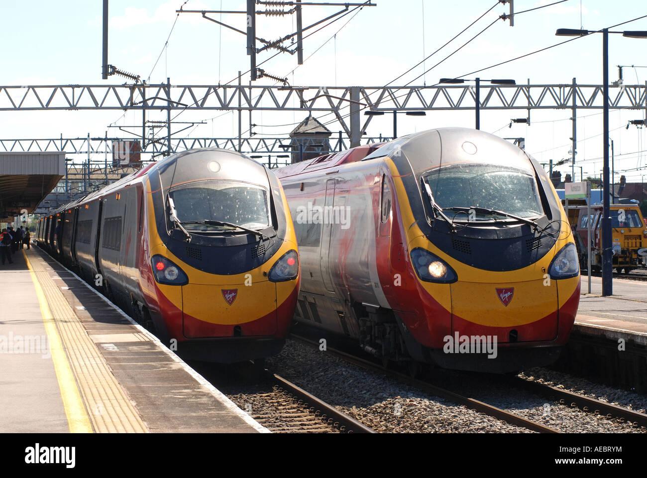 Virgin Trains Pendolino electric trains at Nuneaton station, Warwickshire, England, UK Stock Photo