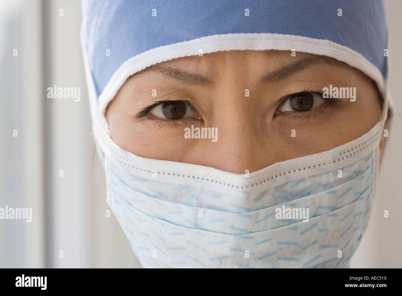 Close up of Asian female doctor wearing surgical mask Stock Photo