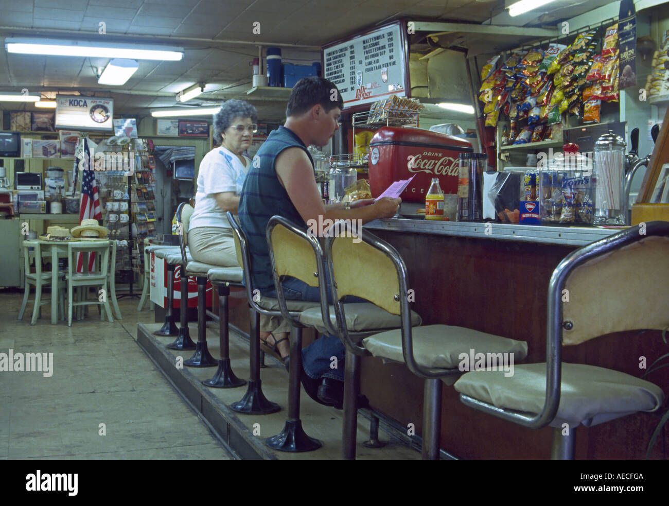 Customers at Hi School Gifts Drugs, historical drugstore in town of New London, Texas, USA - Stock Image