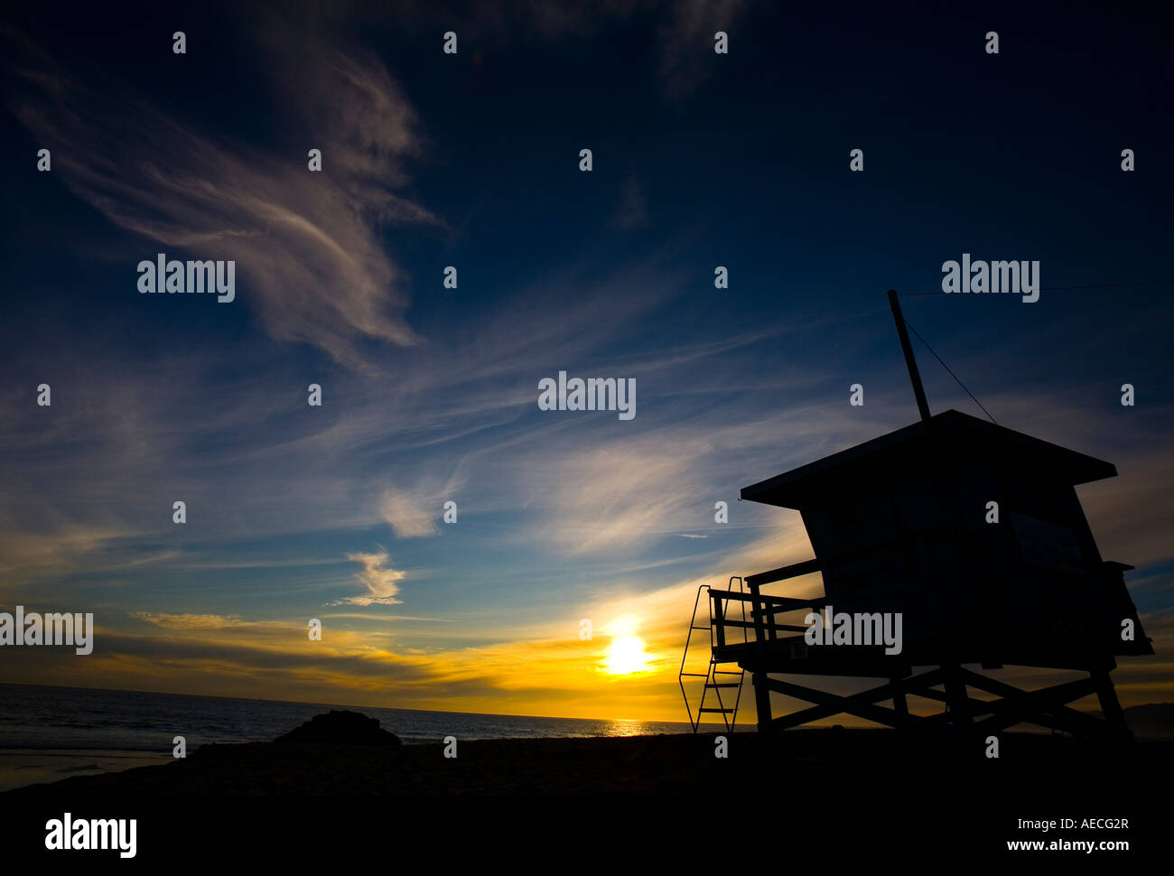The sun sets in front of a beach hut on Venice Beach California USA on March 5th 2007 - Stock Image