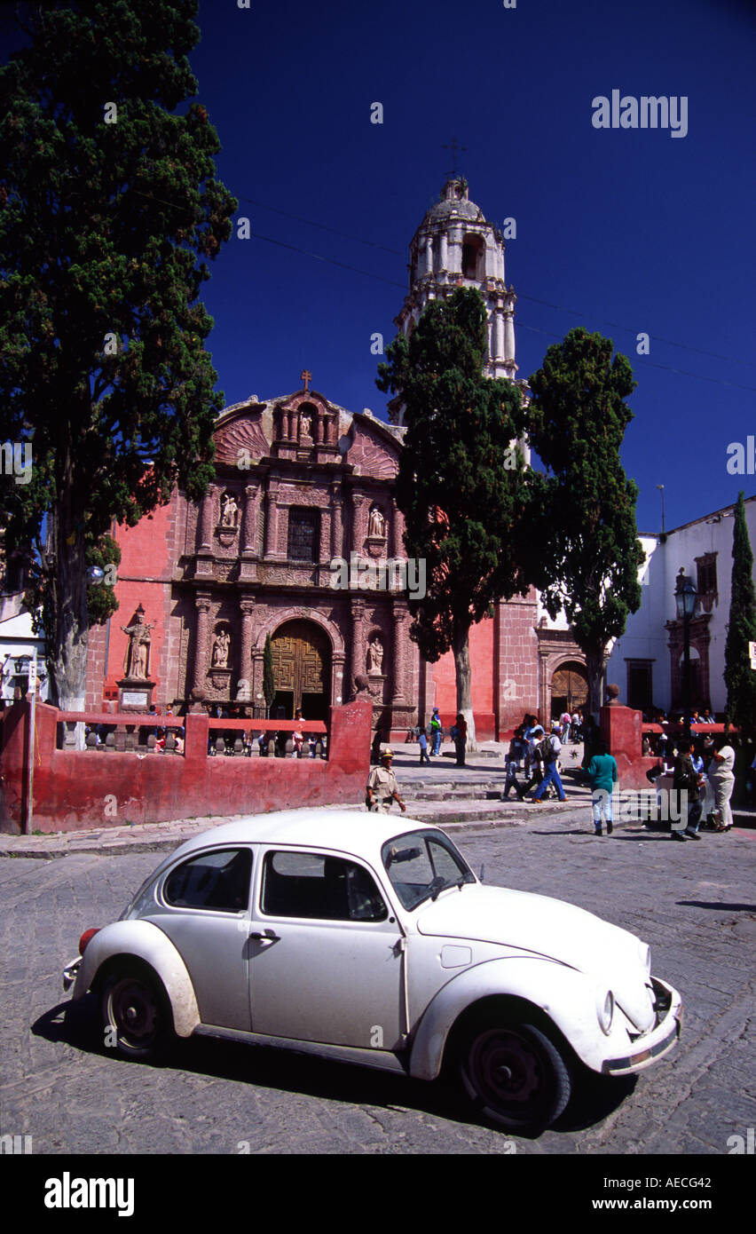 A White Old Fashioned Volkswagen Beetle Passes In Front Of The Church Stock Photo Alamy