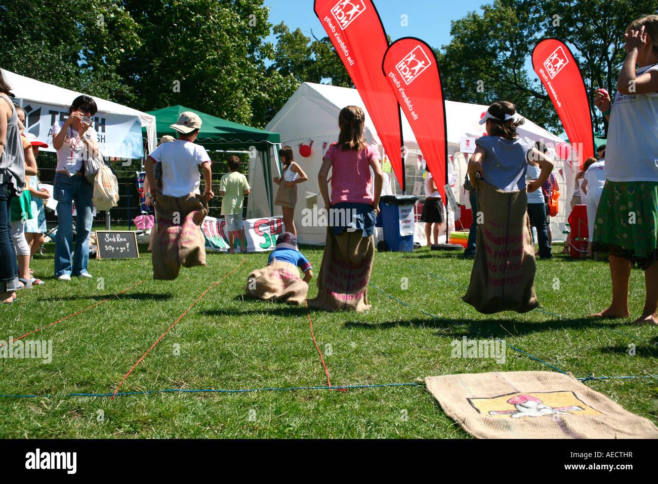 Sack race at Innocent Village Fete, London - Stock Image
