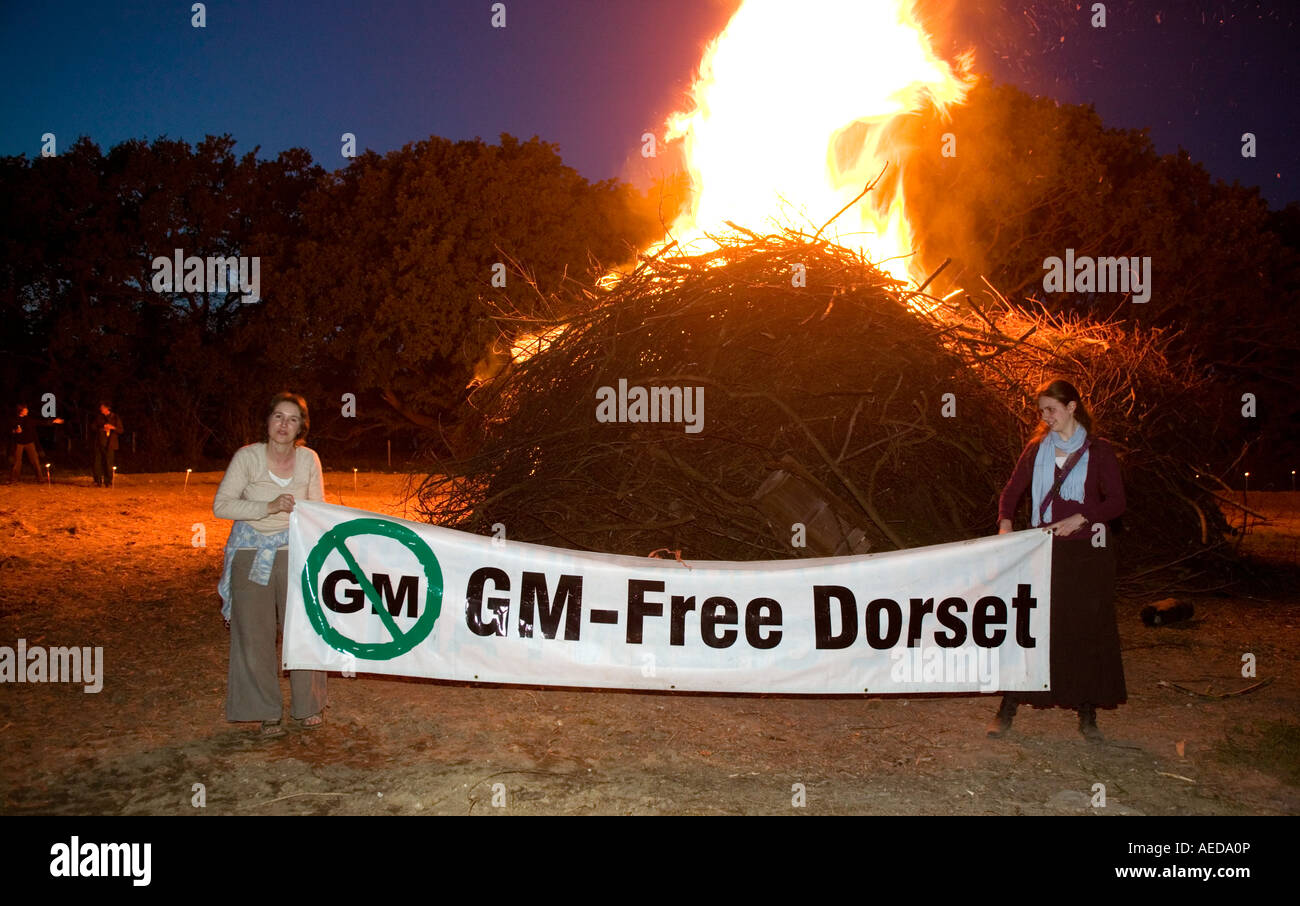 People gathering at beacon in Dorset to campaign against the planting of genetically modified crops in Dorset - Stock Image