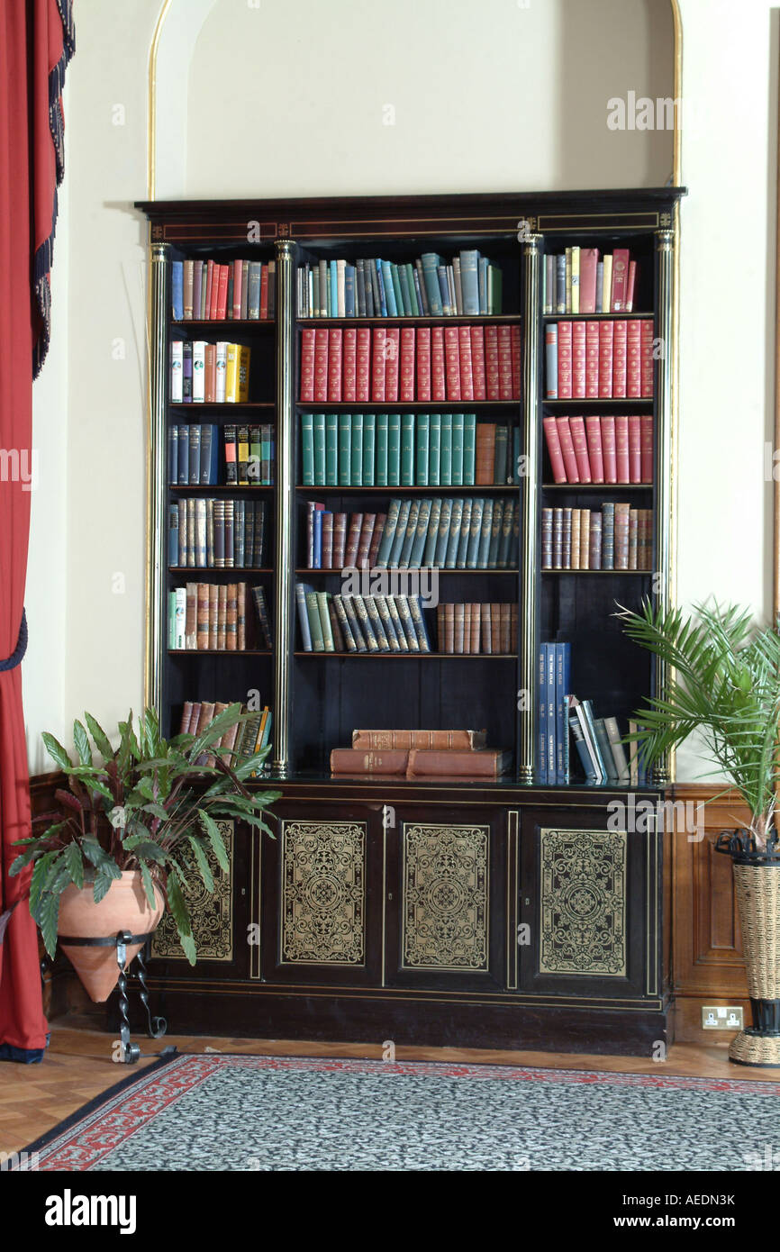 A tall old dark wooden bookcase with